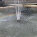 fontaine place neuve arc en ciel